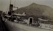 Coast and Geodetic Survey Ship SURVEYOR as seen over the stern of a Navy cruiser.  In service 1917 - 1956.