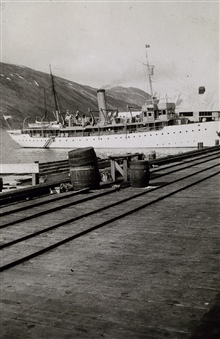 Coast and Geodetic Survey Ship SURVEYOR tied up at Dutch Harbor.In service 1917 - 1956.