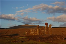 Moon over Rapa Nui, the navel of the world.  Moai at day's end facing inland,restored by Chilean archaeologist Claudio Cristino in the 1990s. Ahu Tongariki.