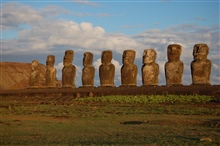 Moai facing inland at Ahu Tongariki, restored by Chilean archaeologist ClaudioCristino in the 1990s.  These are the eight left-most  moai as seen whilelooking at their faces.