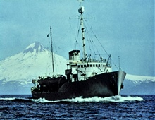 Coast and Geodetic Survey Ship PATHFINDER.In service 1942 - 1971.Shishaldin Volcano in background.This photo appeared in National Geographic in 1957.